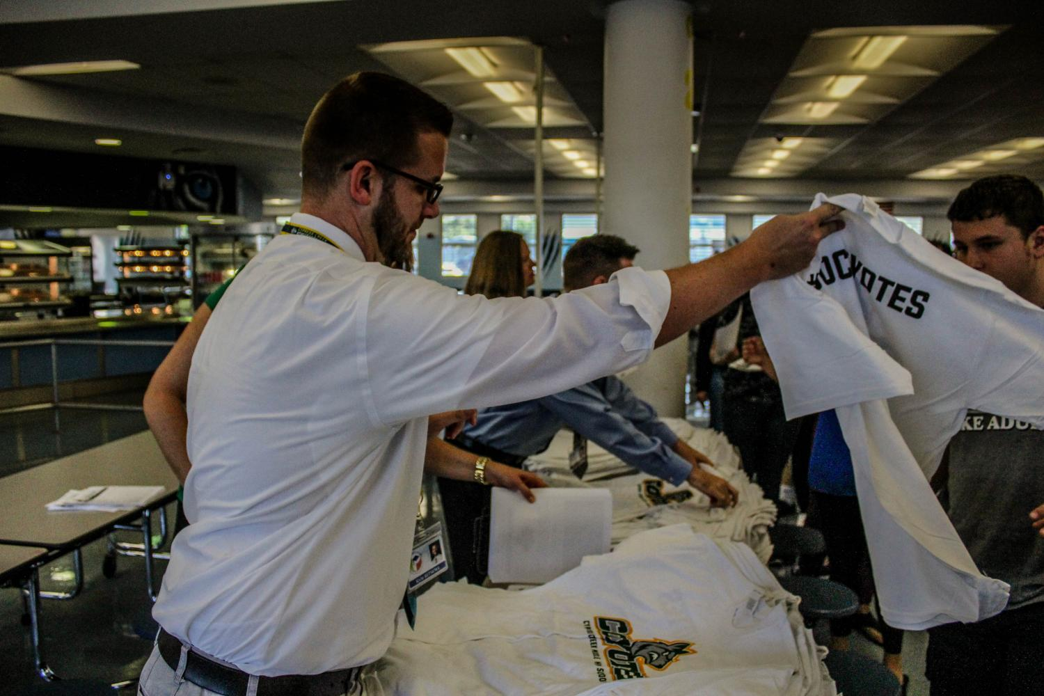 Handing+Out+Shirts+at+WCHS